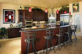 Stylish Wine Themed Kitchen With Brown Cabinets And Red Glass Mini Pendant Lights