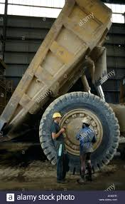 Huge Dump Truck At Ok Tedi Gold Mine Papua New Guinea Stock Photo ... Heavy Excavator Loading Granite Rock Or Iron Ore Into The Huge Watch This Giant Dump Truck Fart Out An Actual Fireball Mine Worker Truck Driver Dwarfed By Huge Ming Dump In American Plastic Toys Gigantic Walmartcom Big Stock Photo Image Of Outdoors Black 62349404 Man Front Wheel Uranium Mine Wheel Loader Sizzlin Cool Beach Color And Styles May Vary At Ok Tedi Gold Papua New Guinea Stock Photo Xxl Rc Cstruction Site Big Scale Model Dump Trucks And Excavator Just A Picture Huge I Mean Just Look It 4k 450 Tone Video Footage Videoblocks