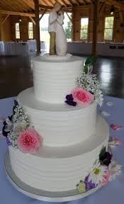 3 Tier Textured Rustic Buttercream Wedding Cake Decorated With Fresh Flowers Cakes White