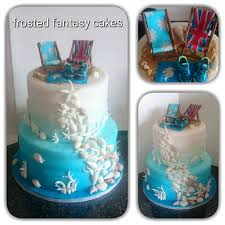 Ombre Beach Themed Two Tiered Wedding Cake Decorated With Gumpaste Seashells And Deck Chairs