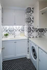 white and black laundry room with hex tiles transitional