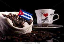 Cuban Flag In A Bag With Coffee Beans Isolated On Black Background