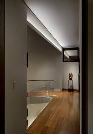 asymmetrical cove light modern hallway landing denver by