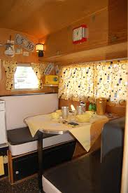 Vintage 1958 Aloha Travel Trailer Dinette Area Decorated With Cheerful Yellow Curtains And Tablecloth