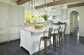 light gray shaker kitchen cabinets with glossy white herringbone