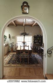 Arched Entrance With Hanging Light Over Dining Table At Home Santa Fe New Mexico USA