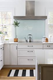 bhg gorgeous l shaped kitchen clean white walls and large windows