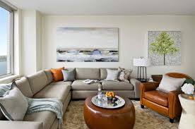 coastal living room with grey sectional sofa part of living room