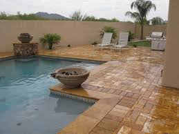 the finished product travertine pavers and coping used for a pool
