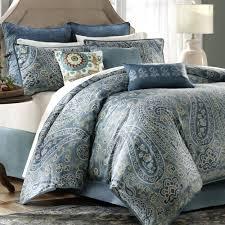 Bedroom Belcourt Blue Paisley Bedding With Rug And Wooden Floor
