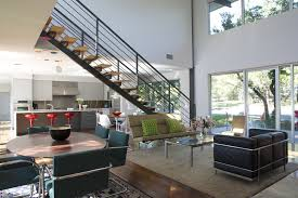 Picture Frames On Staircase Living Room Modern With Round Dining Table Open Floor Plan Metal Railing
