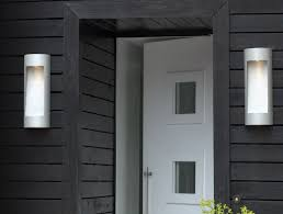 exterior modern white outdoor wall sconce on gray wood siding for
