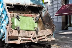 Green Rubbish Container In A Rubbish Truck Stock Photo, Picture And ...