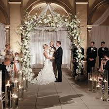 The Couple Wed Beneath A Romantic Altar Woven With Peonies And Hydrangeas From Album Classic Luxury Wedding In Naples FL