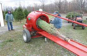 Jeff Costanza Chucks Son Feeds A Tree Into HOWEY Christmas Baler This Protects The And Compacts Them Creating More Space For Transporting