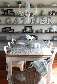 Creative Idea Dining Room Design With Brown Moroccan Stencil Pattern Wooden Table And White Chairs Under Chandelier Also Rustic Wall