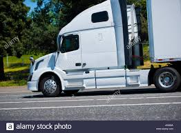 Profile Of Rapid Modern Powerful Semi Truck With A Dry Van Trailer ...