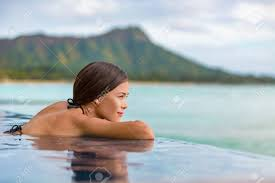 100 Infinity Swimming Luxury Vacation Travel Woman Relaxing In Infinity Swimming Pool