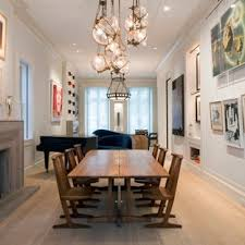 Example Of A Large Trendy Light Wood Floor Enclosed Dining Room Design In New York With