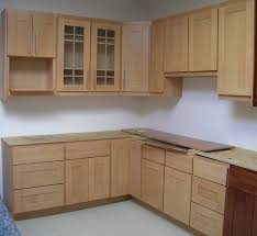 l shaped beige polished wooden cabinet in small kitchen combined