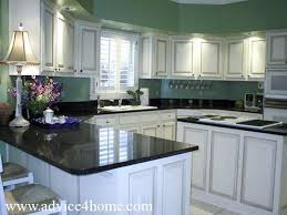 White Washed Cabinets Design And Green Wall Dramatic Black Countertops In Modern Kitchen