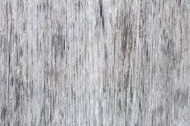 Gray Wooden Background Of Weathered Distressed Unpainted Rustic Wood Showing Woodgrain Texture Stock Photo