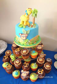 Jungle Baby Shower cake and cupcakes cake by Dlish Cupcakes