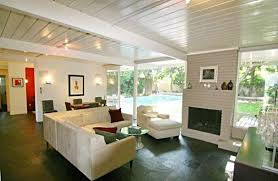 The Home Features An Open Floor Plan With Classic Post And Beam Ceiling To
