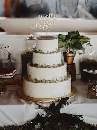 Four Tier White Wedding Cake With Custom Topper
