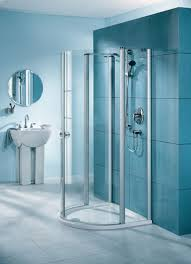 small shower with glass wall and chrome shower modern