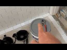 laying ceramic tile in a bathroom