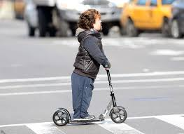 Peter Dinklage Rides A Razor Scooter In New York City