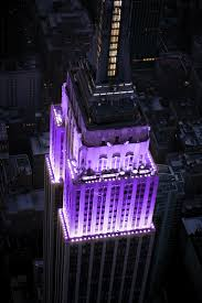 The Empire State Building s tower lights were purple and white at