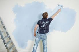 Download Man Painting Wall With Paintroller Stock Image