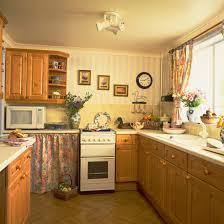 2 Orange Coloured Pine Kitchens