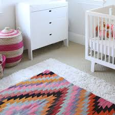 How to Layer Area Rugs in Your Home