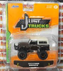 JADA JUST TRUCKS 1973 FORD BRONCO BROWN DIE CAST METAL 1:64 WAVE 10 ...