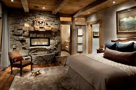 Rustic Stone Fireplaces Bedroom With Area Rug Bed Pillows