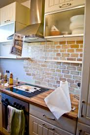 minimalist kitchen area with faux brick white brown painted tile