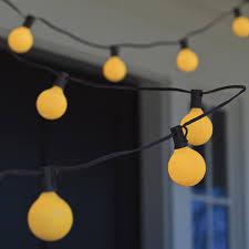 bugs away yellow globe string lights the green