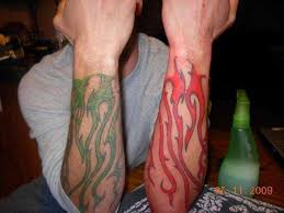 Red Flames Tattoos On Arm Photo