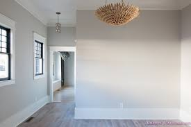 Living Room Light Gray Walls Grey Gold Chandelier Black Window Sashes Whitewashed Hardwood Flooring Blue Doors 5 Of 6
