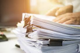 Businessman Hands Searching Information In Stack Of Papers Files On Work Office Business Report