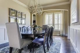 Formal Living Room With Mirrored Wall Art Sphere Shaped Chandeliers Custom Drapery And Upholstered