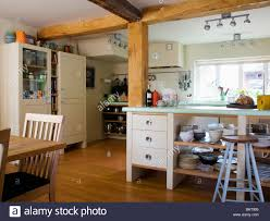 large wooden beams in freestanding country kitchen with open