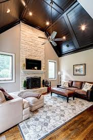 traditional living room with hardwood floors by karen cannon
