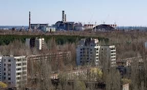 The Town Of Prypyat Is Seen Against Background Damaged Reactor At Chernobyl Nuclear Power Plant In Ukraine Tuesday April 23 2013
