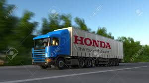 Freight Semi Truck With Honda Logo Driving Along Forest Road ...
