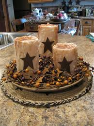 Primitive Decorating Ideas For Kitchen by Centerpiece With Rustic Candles And Wood Bowl Primitive