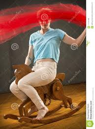 Woman Waving Red Fabric While Riding A Wooden Rocking Horse ...
